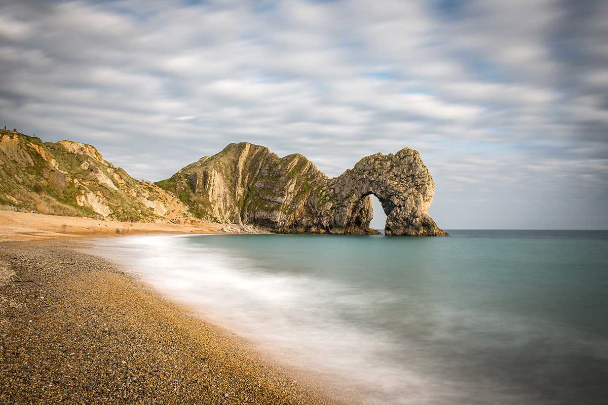 Passing Time At Durdle Door