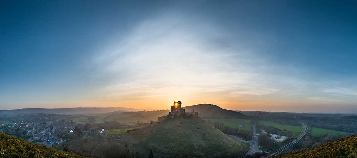 Sun Sets Through Corfe Castle